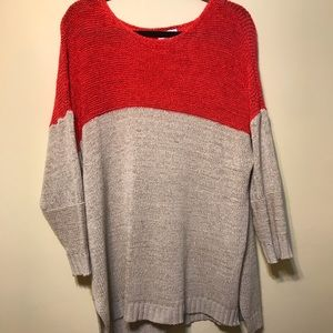 Orange top and cream bottom and sleeves sweater